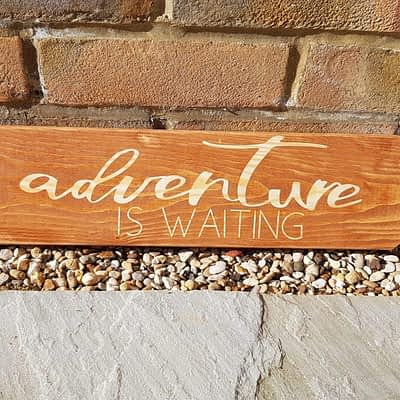 Adventure Is Waiting sign